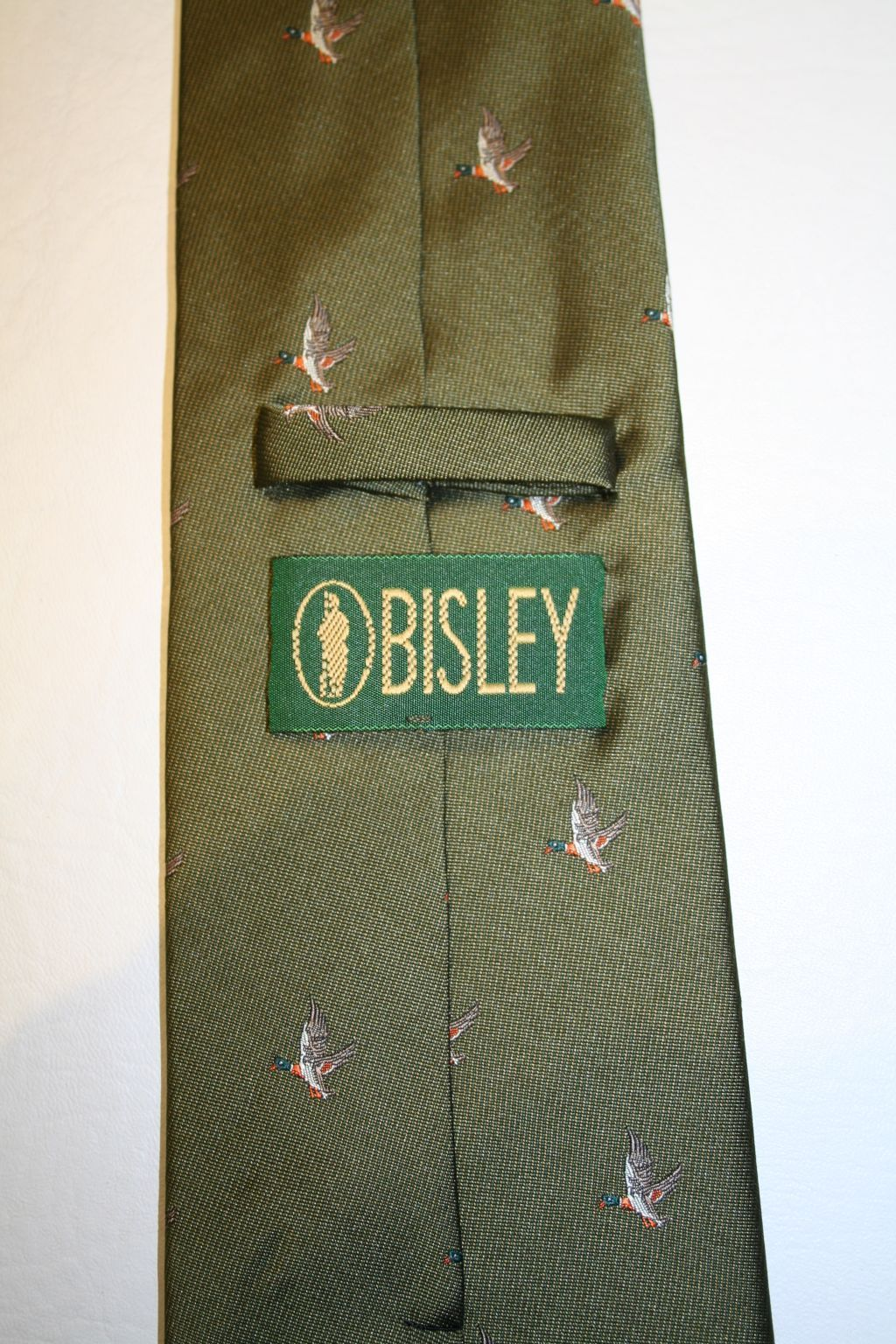 Bisley Shooting Tie Featuring Flying Ducks On Green Background